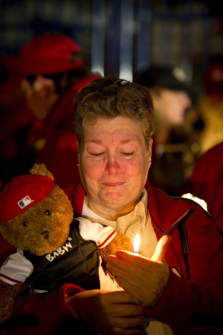 Mary Brick of Centreville, Va, gets emotional as she holds a teddy bear and a candle during a candlelight vigil for Nationals' rookie catcher Wilson Ramos at Nationals Park in Washington, DC, Friday, November 11, 2011. Ramos was kidnapped by armed gunmen in front of his family home in Venezuela on Wednesday night. (Rod Lamkey Jr. / The Washington Times)