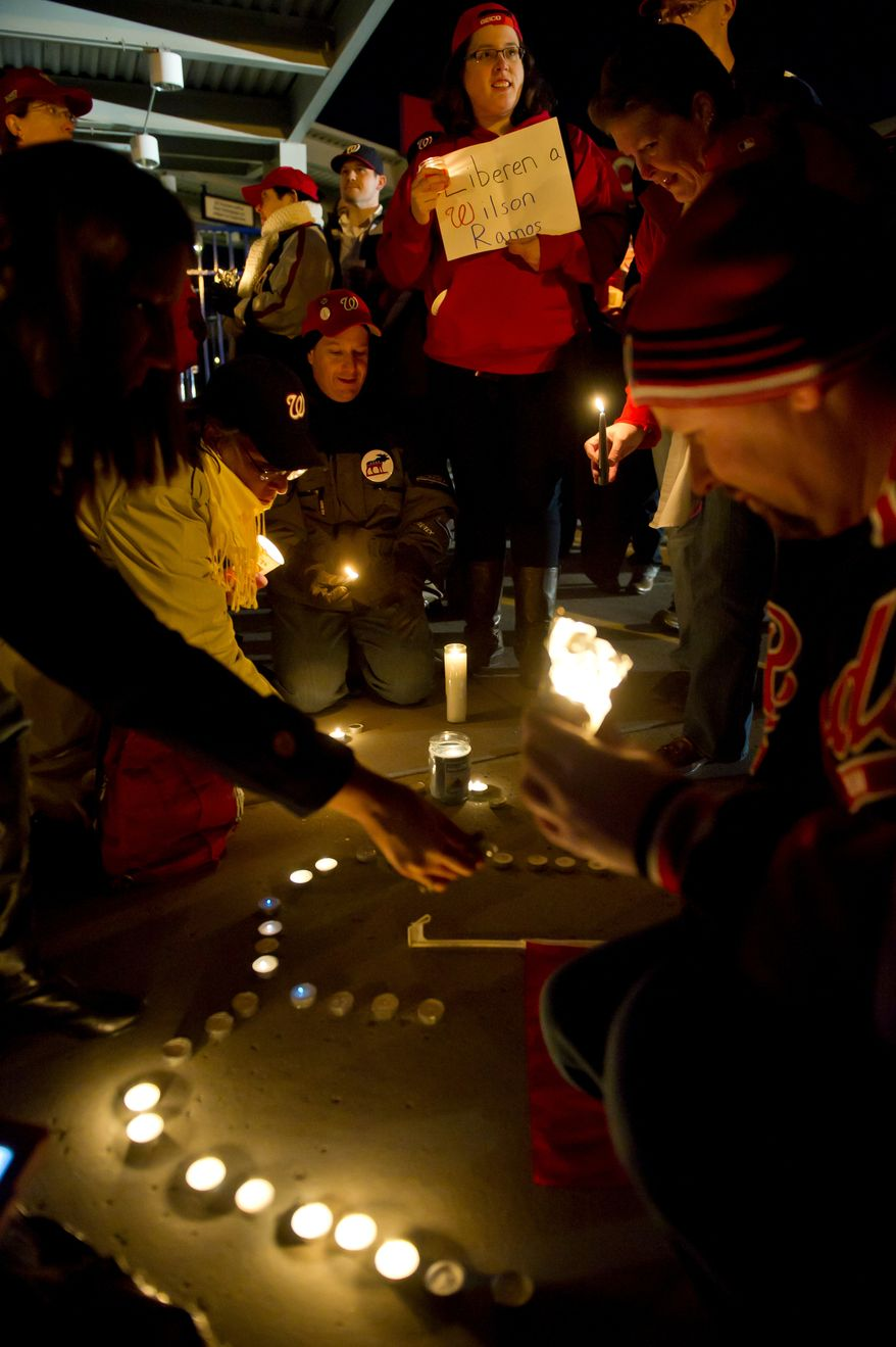 "Votive candles laid out in the pattern of the letter ""W"" are lit during a candlelight vigil for Nationals' rookie catcher Wilson Ramos at Nationals Park in Washington, DC, Friday, November 11, 2011. Ramos was kidnapped by armed gunmen in front of his family home in Venezuela on Wednesday night. (Rod Lamkey Jr. / The Washington Times)"