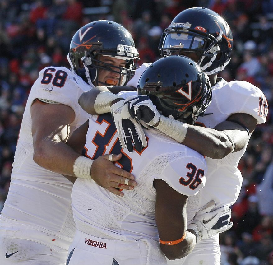 Virginia's Max Milien (36) celebrates his touchdown with teammates Anthony Mihota (68) and Kris Burd in the second half against Maryland in College Park, Md., Saturday, Nov. 5, 2011. Virginia won 31-13. (AP Photo/Patrick Semansky)