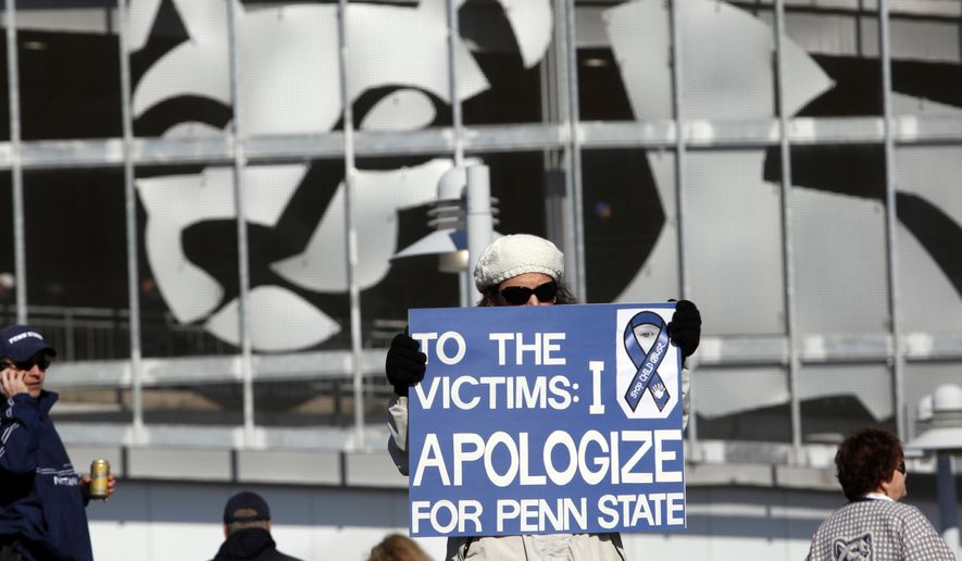 A Penn State alum who declined to give her name holds a sign outside Beaver Stadium before an NCAA college football game between Penn State against Nebraska, Saturday, Nov. 12, 2011 in State College, Pa. Penn State is playing for the first time in decades without former head coach Joe Paterno, after he was fired in the wake of a child sex abuse scandal involving a former assistant coach. (AP Photo/Alex Brandon)
