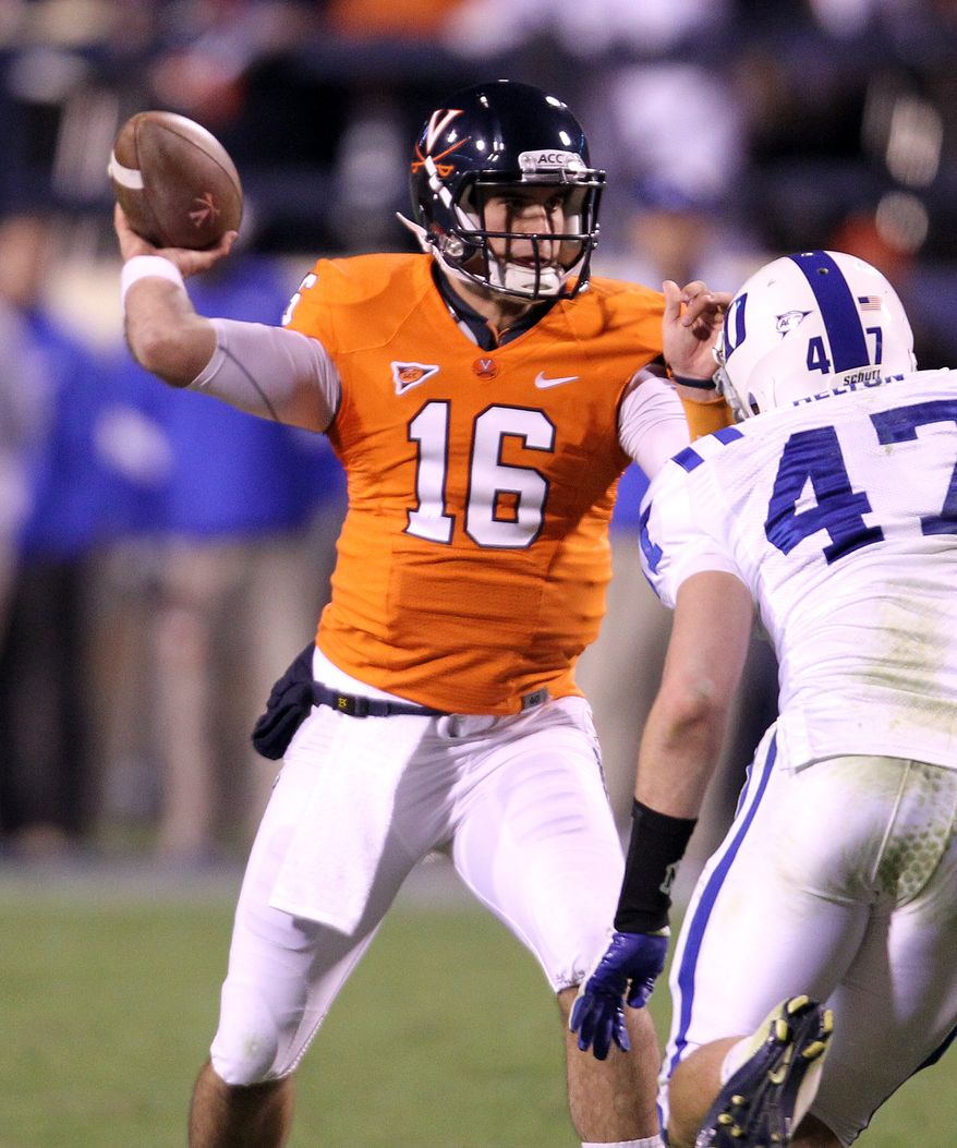 Virginia quarterback Michael Rocco threw for two touchdowns and 191 yards in Virginia's 31-21 win over Duke on Saturday night. (AP Photo/Andrew Shurtleff)