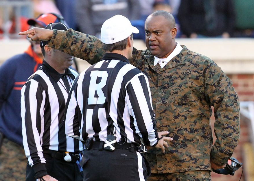 Virginia head coach Mike London argues with referees about a call during the first half against Duke on Saturday, Nov. 12, 2011, Charlottesville, Va. (AP Photo/Andrew Shurtleff)