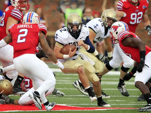 Navy quarterback Kriss Proctor didn't complete a pass all game (going 0-for-2 with an interception), but he ran for 107 yards as Navy kept its bowl hopes alive with a win over SMU. (AP Photo/John F. Rhodes)