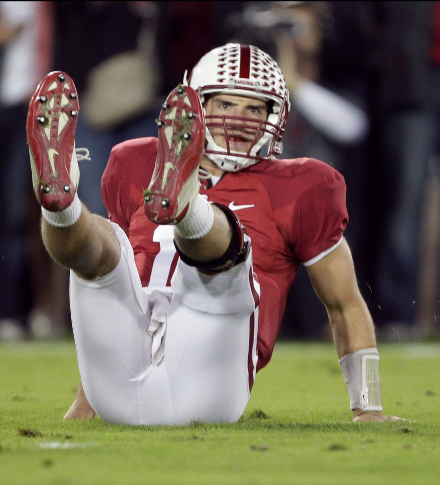 Stanford quarterback Andrew Luck saw his team's hopes of playing in the BCS National Championship derailed with a 53-30 loss at home to Oregon on Saturday. The Cardinal dropped to 9-1 with two games remaining. (Associated Press)