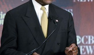 Republican presidential hopeful Herman Cain, seen here at a candidates debate on CBS-TV Saturday night in Spartanburg, S.C., has been critical of the media's coverage of his campaign. (Associated Press)