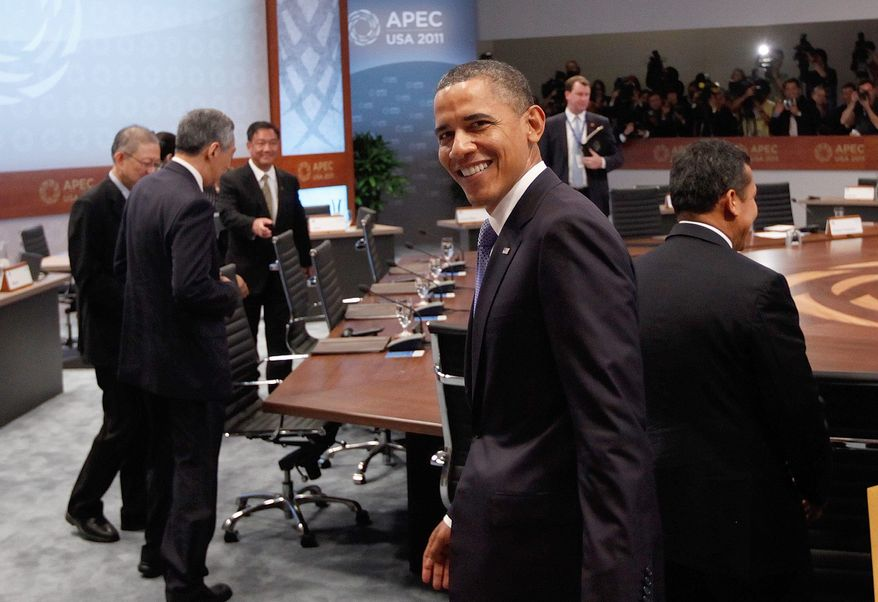 President Obama arrives Sunday at the Asia-Pacific Economic Cooperation summit in Honolulu. Mr. Obama said China must adhere to international trade rules and stop infringing upon U.S. intellectual property rights. (Associated Press)
