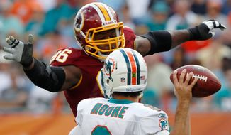 Washington Redskins nose tackle Barry Cofield pressures Miami Dolphins quarterback Matt Moore during the first quarter Sunday, Nov. 13, 2011, in Miami. (AP Photo/Hans Deryk)