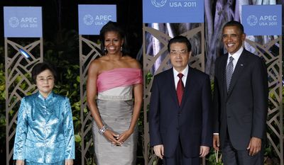 President Obama (right) and his wife Michelle (second from left) greet Chinese President Hu Jintao (second from right) and his wife Liu Yongqing before their dinner at the APEC Summit in Honolulu on Nov. 12, 2011. (Associated Press)