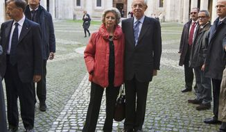 **FILE** Italian economist Mario Monti and his wife Elsa leave St. Ivo church in Rome following a Mass on Nov. 13, 2011. (Associated Press)
