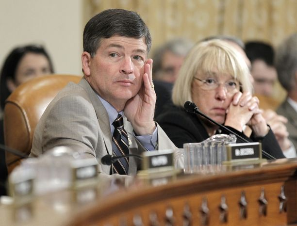 Rep. Jeb Hensarling (left), Texas Republican, and Sen. Patty Murray, Washington Democrat, co-chairs of the Joint Select Committee on Deficit Reduction, sit together as the supercommittee meets on Capitol Hill on Nov. 1, 2011. (Associated Press)**FILE**
