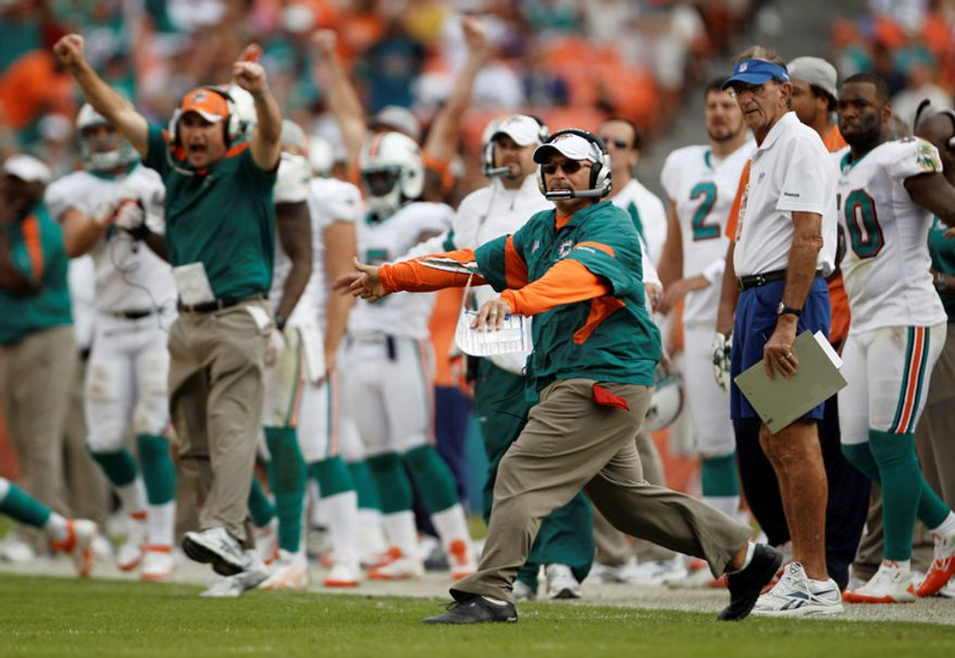 Miami Dolphins coach Tony Sparano, center, celebrates after the Washington Redskins missed a field goal during the second half. The Dolphins won 20-9. (AP Photo/J Pat Carter)