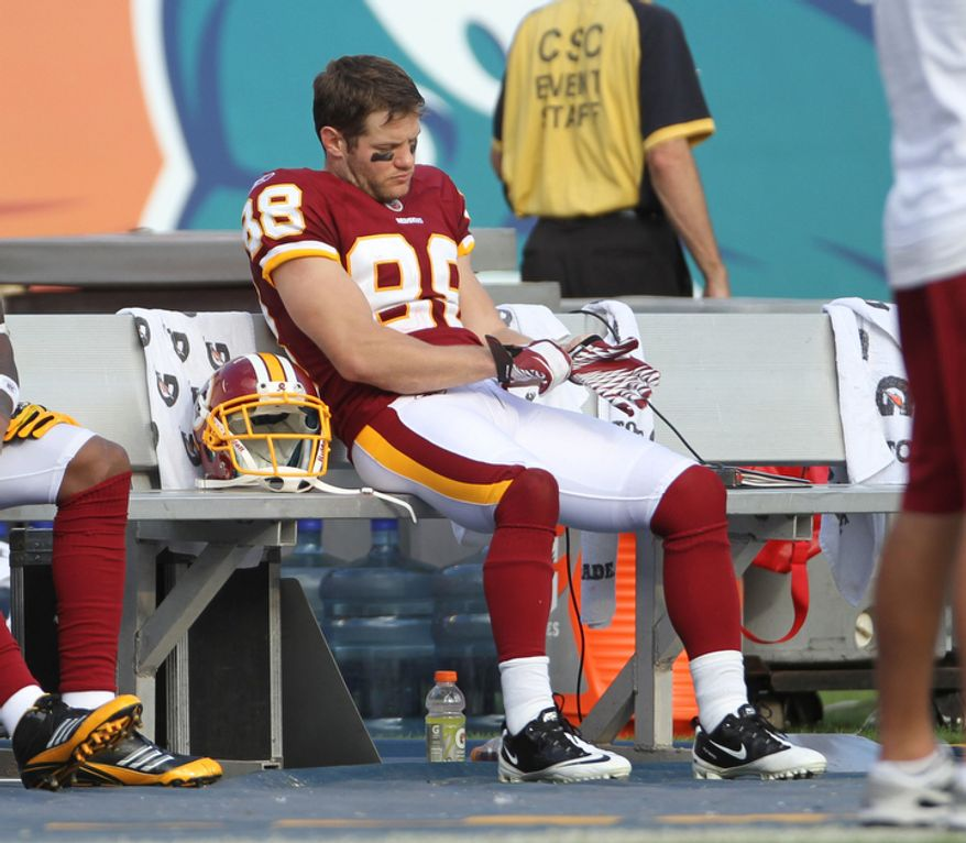 Washington Redskins' David Anderson sits on the bench during the final minute of an NFL football game against the Miami Dolphins in Miami, Sunday, Nov. 13, 2011. The Dolphins won 20-9.  (AP Photo/J Pat Carter)