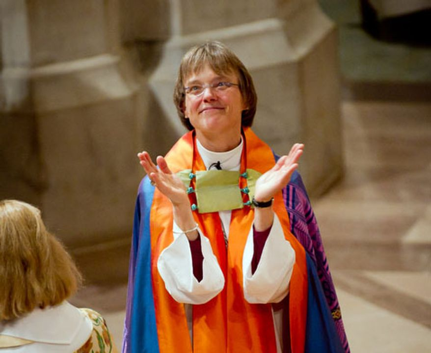 The Reverend Dr. Mariann Edgar Buddle claps with the congregation after her sermon after being seated as the ninth bishop of Washington. (Andrew Harnik / The Washington Times)