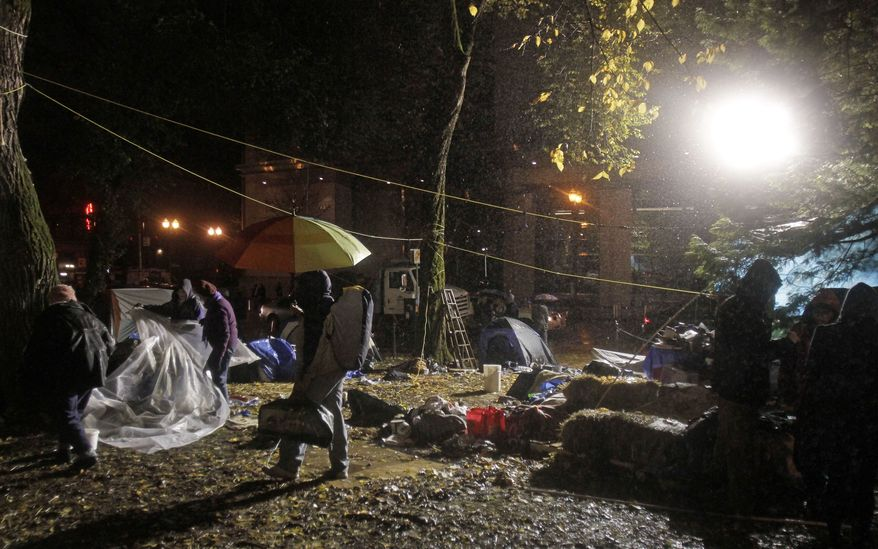 Protesters in Portland, Ore., pack up and leave hours before a mandate from the city to vacate the Occupy Portland Camp on Nov. 12, 2011. (Associated Press)