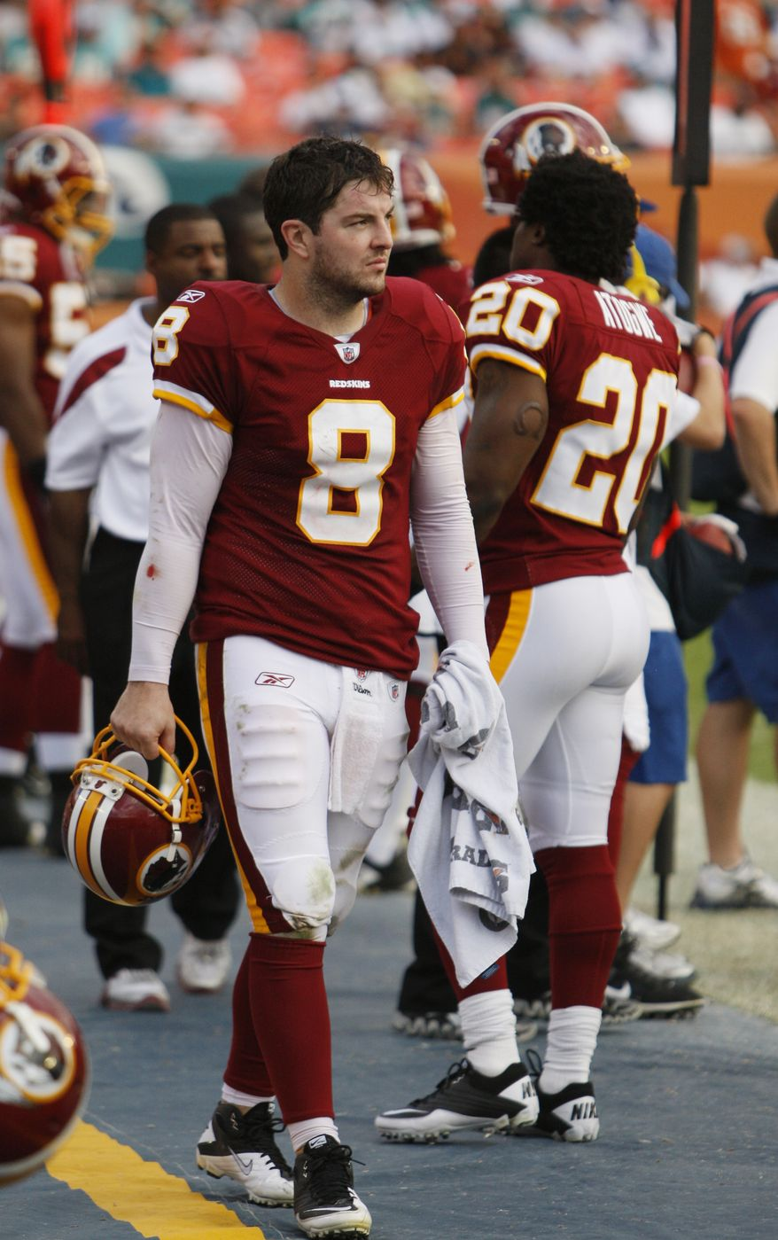 Washington Redskins quarterback Rex Grossman is shown on the sidelines during the second half  against the Miami Dolphins, Sunday, Nov. 13, 2011, in Miami. The Dolphins defeated the Redskins 20-9. (AP Photo/Wilfredo Lee)