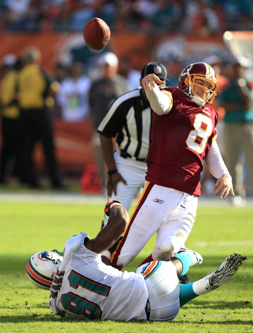Washington Redskins quarterback Rex Grossman (8) gets off a pass as he is pressured by Miami Dolphins outside linebacker Cameron Wake during the fourth quarter of an NFL football game Sunday, Nov. 13, 2011, in Miami. (AP Photo/Wilfredo Lee)