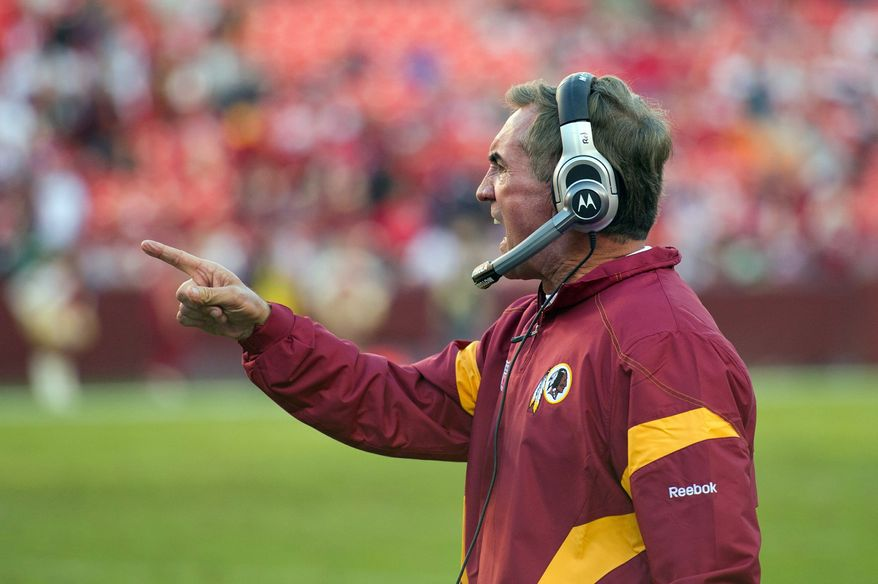 Mike Shanahan is 9-16 since taking over in Washington as the head coach, while Mike Holmgren is 8-17 since taking over as team president in Cleveland. (Rod Lamkey Jr./The Washington Times)