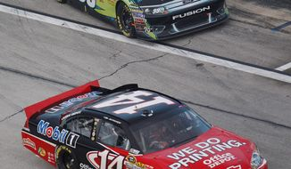 Tony Stewart (14) trails Carl Edwards (99) by three points heading into the final Sprint Cup race, Sunday at Homestead-Miami Speedway. One or the other will be the new champion. (Associated Press)