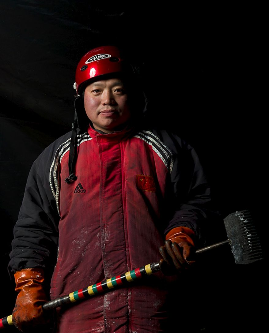 """Niu Pei Xiang, 45, is one of the men from Harbin, China, the artisan ice sculptors who came to the United States to create colorful scenes from the DreamWorks' production of """"Merry Madagascar"""" for this years ICE! show in National Harbor, Md, Thursday, November 9, 2011. (Rod Lamkey Jr. / The Washington Times)"""