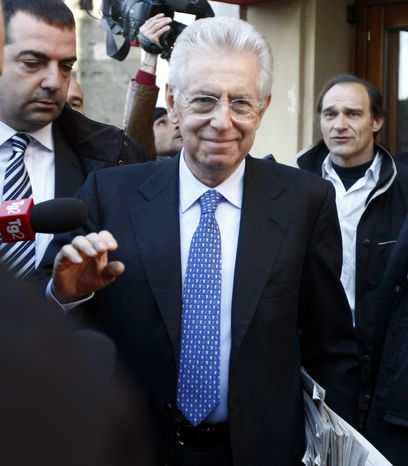 Italy's new premier-designate economist Mario Monti leaves the hotel to start talks with parties' representatives in Rome on Nov. 14, 2011. (A