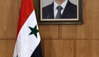 Syrian Foreign Minister Walid al-Moallem speaks during a press conference in Damascus, Syria, on Nov. 14, 2011. (Associated Press)