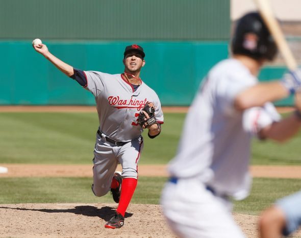 """Nationals prospect Rafael Martin, 27, shown during an Arizona Fall League game, thrives on the motion of his pitches. """"I find my release point where the ball is cutting a lot and I'll stay there,"""" he said. He's setting his sights on starting the 2012 season at Triple-A. (Rick Scuteri/Special to The Washington Times)"""