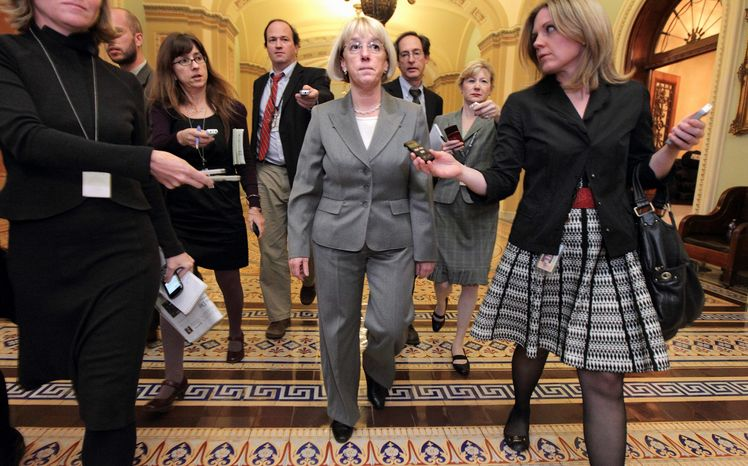 With reporters looking for an update Tuesday, Sen. Patty Murray, Washington Democrat and co-chairman of the Joint Select Committee on Deficit Reduction, walks through the Capitol after a closed-door meeting with Democratic members of the supercommittee. The panel faces a Nov. 23 deadline to come up with a plan. (Associated Press)