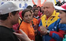 In this photo provided by Miraflores Presidential Press Office, Venezuelan President Hugo Chavez (second from right) speaks Nov. 13. 2011, to a supporter during a rally in Caracas, Venezuela. (Associated Press/Miraflores Presidential Office)