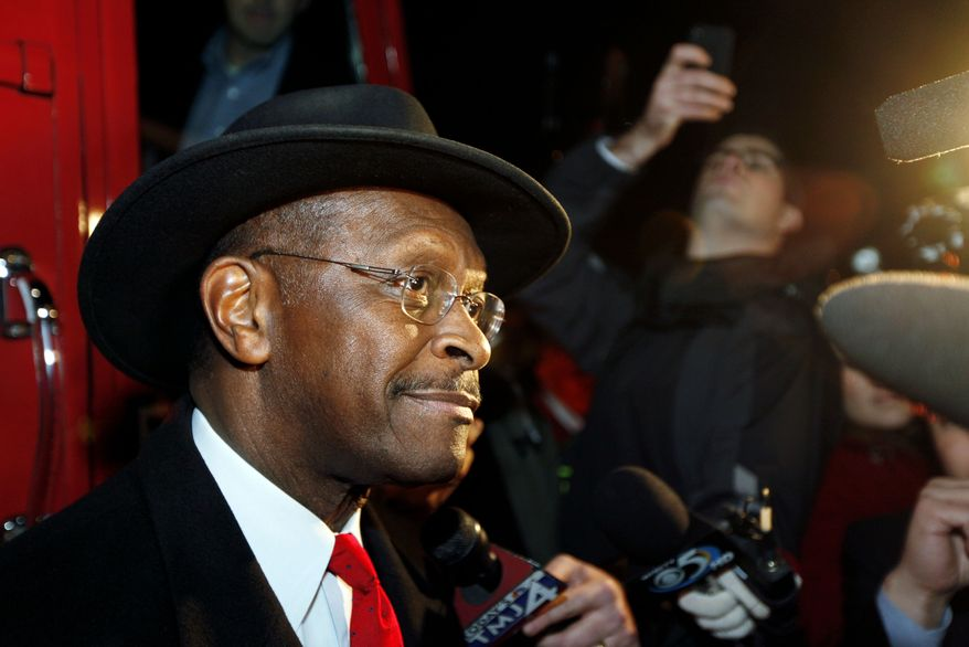 Republican presidential candidate Herman Cain talks to reporters on Nov. 14, 2011, before greeting supporters at a fundraising event before an NFL football game between the Green Bay Packers and the Minnesota Vikings in Green Bay, Wis. (Associated Press)