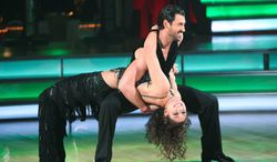 "In this Nov. 14, 2011 image released by ABC, soccer player Hope Solo and her partner Maksim Chmerkovskiy perform on the celebrity dance competition series ""Dancing with the Stars,"" in Los Angeles. (AP Photo/ABC, Adam Taylor)"