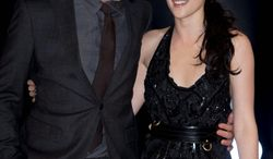 """Robert Pattinson and Kristen Stewart star in """"The Twilight Saga: Breaking Dawn, Part 1."""" Fans are eager to see the bridal gown her character will be wearing in the film that will be released Friday.  (Associated Press)"""