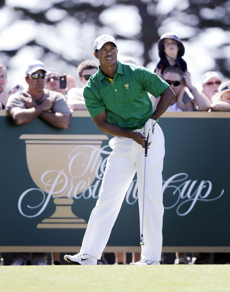 Tiger Woods, eyeing a tee shot during a practice round before the Presidents Cup, and David Toms were partners in a Presidents Cup win at Royal Montreal. (Associated Press)