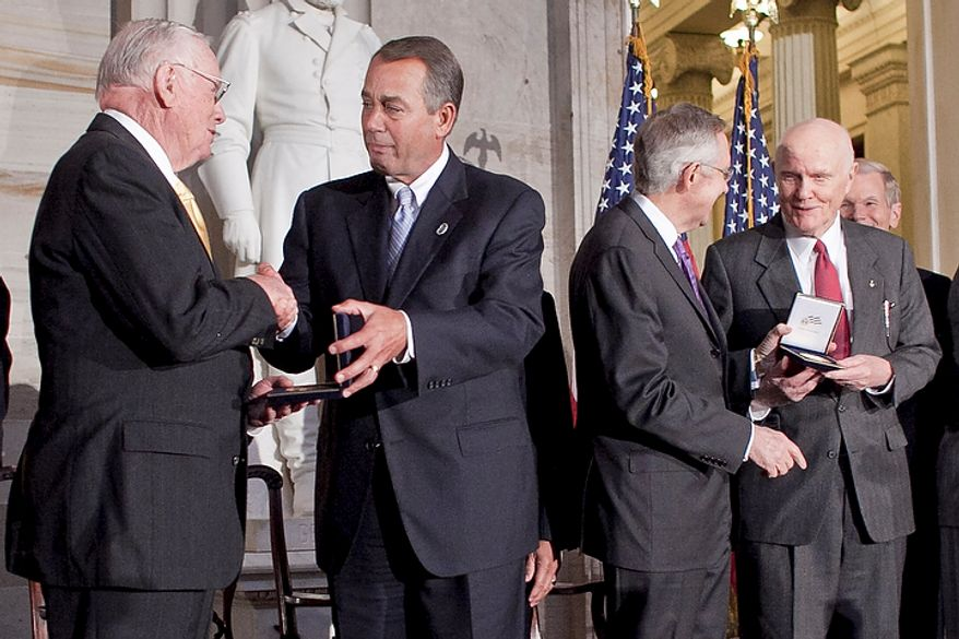 House Speaker John Boehner (second from left), Ohio Republican, reacts emotionally Nov. 16, 2011, while presenting a Congressional Gold Medal to astronaut Neil Armstrong (left) as Senate Majority Leader Harry Reid (second from right), Nevada Democrat, presents a Congressional Gold Medal to astronaut John Glenn during a Congressional Gold Medal ceremony at the Capitol building in Washington. (T.J. Kirkpatrick/The Washington Times)