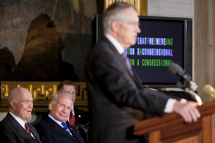 From left: Astronauts John Glenn and Buzz Aldrin listen to Senate Majority Leader Harry Reid, Nevada Democrat, during a Congressional Gold Medal ceremony at the Capitol building in Washington on Nov. 16, 2011. (T.J. Kirkpatrick/The Washington Times)