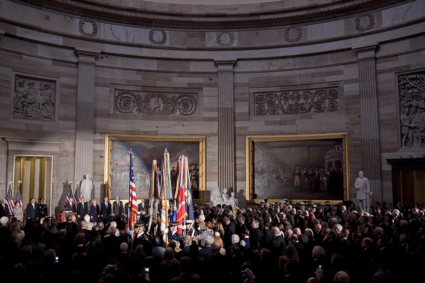 The U.S. Armed Forces Color Guard presents the colors on Nov. 16, 2011, during a Congressional Gold Medal ceremony in honor of astronauts Michael Collins, Neil Armstrong, John Glenn and Buzz Aldrin at the Capitol building in Washington. (T.J. Kirkpatrick/The Washington Times)
