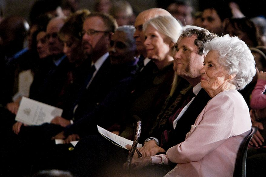 Ann Glenn (right), wife of astronaut John Glenn, listens to a speaker Nov. 16, 2011, during a Congressional Gold Medal ceremony in honor of Glenn and fellow astronauts Michael Collins, Neil Armstrong and Buzz Aldrin at the Capitol building in Washington. (T.J. Kirkpatrick/The Washington Times)