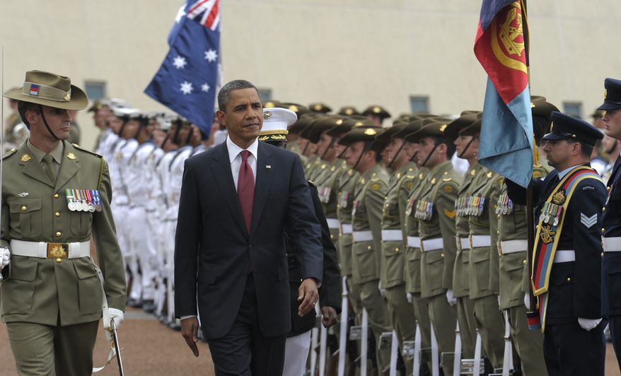 President Obama reviews the troops with Federation Guard Maj. John Cottis (left) during an official arrival ceremony on Nov. 16, 2011, at Parliament House in Canberra, Australia. (Associated Press)