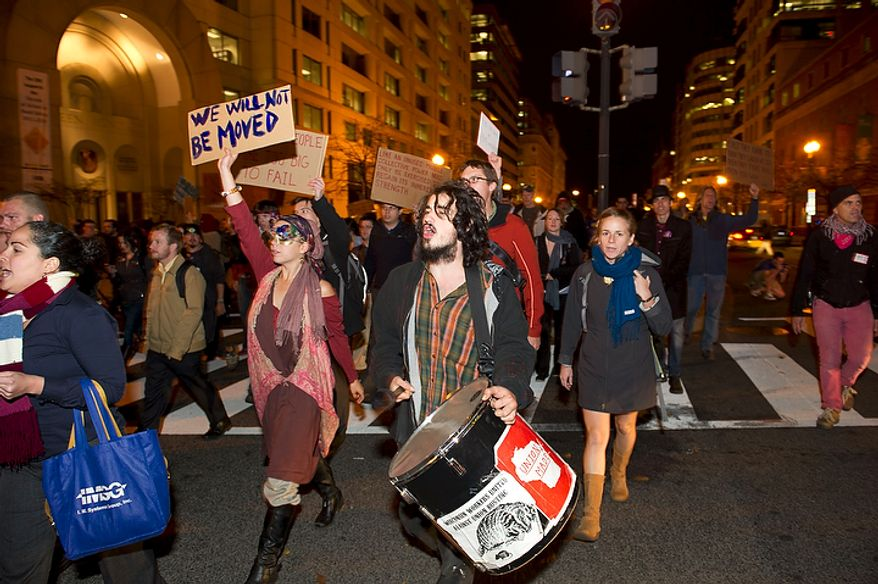 Demonstrators with the Occupy D.C. take to the streets of downtown Washington, D.C., Tuesday, Nov. 15, 2011, to show support for the Occupy Wall Street movement. (Rod Lamkey Jr./The Washington Times)