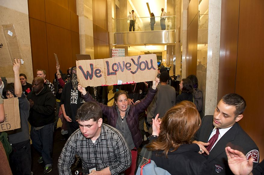 Demonstrators with Occupy D.C. occupy the lobby of the Victor Building in downtown Washington, D.C., Tuesday, Nov. 15, 2011, while marching to show support for the Occupy Wall Street movement. (Rod Lamkey Jr./The Washington Times)