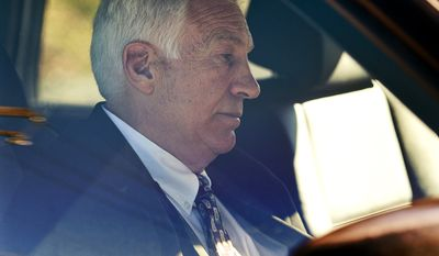"** FILE ** Former Penn State football defensive coordinator Gerald ""Jerry"" Sandusky sits in a car as he leaves the office of Centre County Magisterial District Judge Leslie A. Dutchcot in State College, Pa., on Saturday, Nov. 5, 2011. (AP Photo/Harrisburg Patriot-News, Andy Colwell, File)"