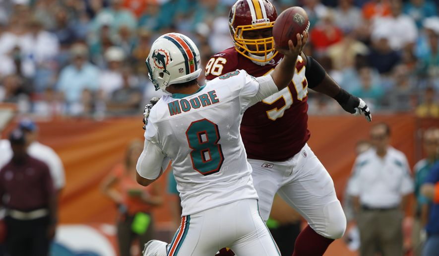 Washington Redskins nose tackle Barry Cofield (96) pressures Miami Dolphins quarterback Matt Moore during the first quarter of the Dolphins' 20-9 home win on Nov. 13, 2011. (Associated Press)