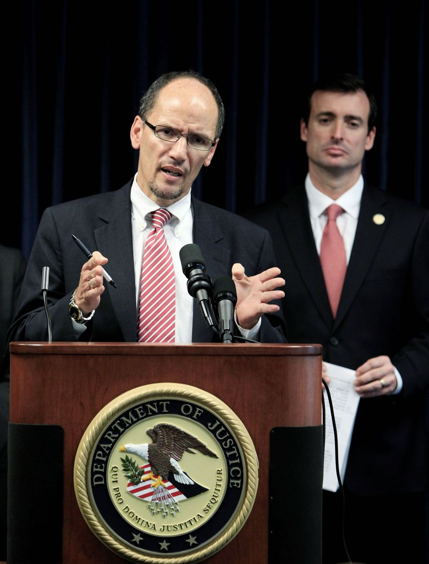 Thomas Perez, assistant attorney general for civil rights, speaks during a news conference with Miami U.S. Attorney Wifredo Ferrer in Miami. (Associated Press)