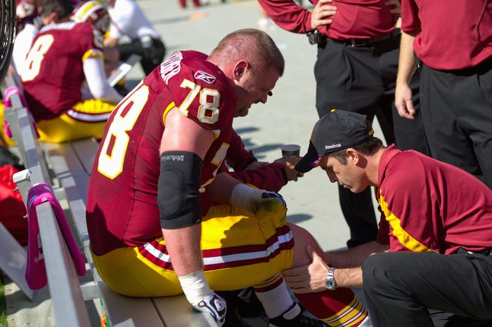 Offensive lineman Kory Lichtensteiger suffered extensive damage to his knee on Oct. 16, 2011, against the Philadelphia Eagles. (Andrew Harn