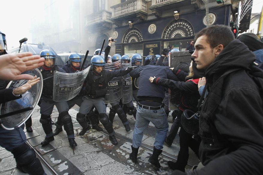 Students clash with police during a demonstration in Milan, Italy, on Nov. 17, 2011. University students protested in Milan and Rome against budget cuts and a lack of jobs, hours before new Italian Premier Mario Monti reveals his anti-crisis strategy in Parliament. (Associated Press)