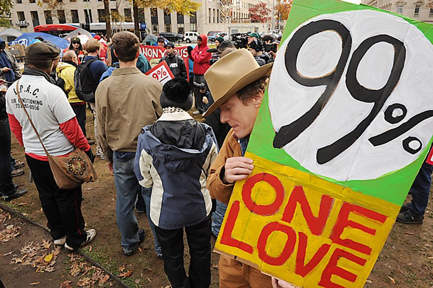 Occupy D.C. protesters prepare to march Nov. 17, 2011, from McPherson Square to the Key Bridge in Washington's Georgetown neighborhood. (Andrew Harnik/The Washington Times)