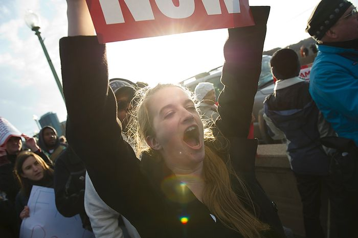 A woman shouts out as she walks with her sigh on the Key Bridge as a confluence of different protest groups converge on the Key Bridge in Washington, DC, Thursday, November 17, 2011. (Rod Lamkey Jr. / The Washington Times)