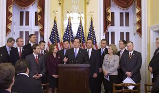 ** FILE ** Members of the House Republican freshman class, led by class President Rep. Austin Scott, R-Ga., center, gestures during a news conference on Capitol Hill in Washington, Thursday, Nov. 17, 2011, to discuss a Balanced Budget Amendment. (AP Photo/Harry Hamburg)