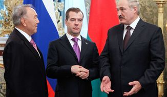 From left, Presidents of Kazakhstan Nursultan Nazarbayev, Russia Dmitry Medvedev and Belarus Alexander Lukashenko meet in Moscow's Kremlin on Friday, Nov. 18, 2011. (AP Photo/RIA Novosti, Dmitry Astakhov, Presidential Press Service)