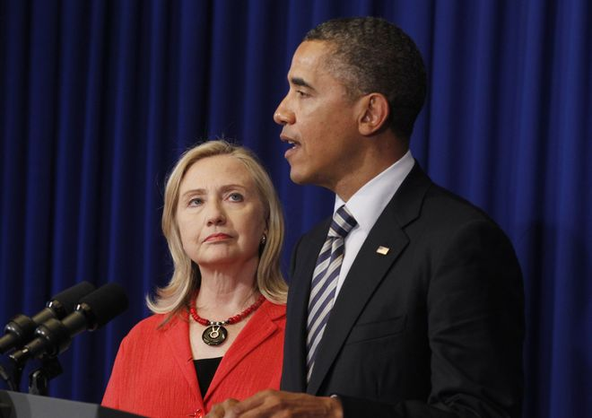U.S. President Barack Obama stands with Secretary of State Hillary Rodham Clinton as he announces that she will travel to Myanmar, on the sidelines of the ASEAN and East Asia summit in Nusa Dua, on the island of Bali, Indonesia, Friday, Nov. 18, 2011. (AP Photo/Charles Dharapak)