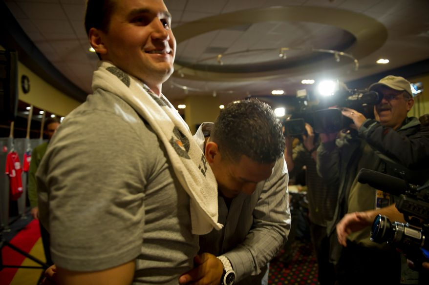 Wilson Ramos gives a bear hug to teammate Ryan Zimmerman, who happened to be at Nationals Park working out, after a brief press conference.